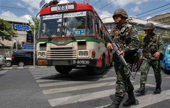 تايلاند.. أطفال يلهون بالأسلحة تحت أعين الجيش