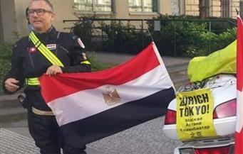 شريف لطفي يقطع 19 ألف كم بدراجته البخارية من الأرجنتين إلى أمريكا رافعًا علم مصر