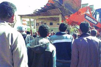 إزالة 3 أكشاك مخالفة بجوار مصلحة الدمغة بالجمالية في حى وسط القاهرة