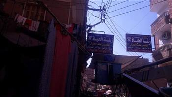 إزالة إعلانات غير مرخصة فى شوارع حى حلوان