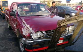 بالصور.. إصابة 7 عمال فى حادث انقلاب سيارة نقل بمحور التسعين