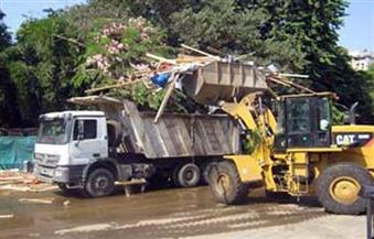 رفع مخلفات القمامة من شوارع حي مصر الجديدة