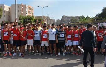"""""""جامعة بورسعيد"""" تنظم """"ماراثون رياضي"""" على روح الشهداء"""
