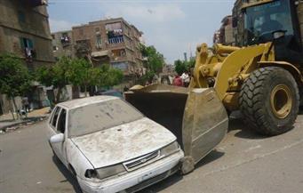 """حي منشأة ناصر يرفع سيارات متهالكة من """"الأوتوستراد"""""""