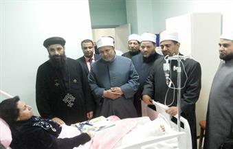 بالصور.. وفد من الأزهر يزور مصابي حادث الكنيسة البطرسية في المستشفيات