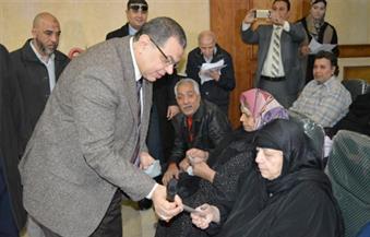 """بالصور.. """"سعفان"""" يسلم 87 مستحقًا للمعاشات التقاعدية """"هويات"""" الصرف لدى العراق"""
