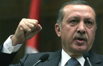 أردوغان يهاتف بوتين بعد اغتيال السفير الروسي