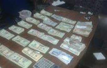 ضبط صاحب مصنع ومندوب مبيعات يتاجران فى العملات الأجنبية بالإسكندرية