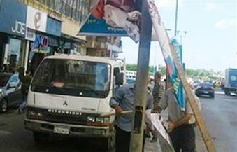 إزالة 22 إعلانًا مخالفًا من على واجهات المحلات بشارع الأزهر