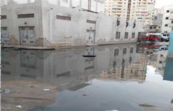 بالصور.. عودة مشاكل الصرف الصحى لمساكن الحرمين بالإسكندرية