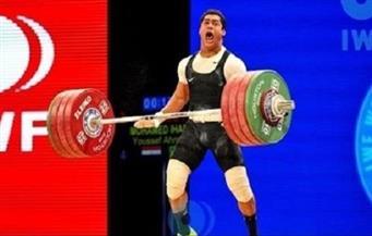 """جامعة الفيوم تكرم والدة البطل محمد إيهاب بعد حصوله على """"برونزية الأولمبياد"""""""