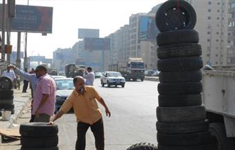 """بالصور.. """"النقل"""" تنفذ حملة لرفع الإشغالات أعلى """"الدائري"""" بدار السلام"""