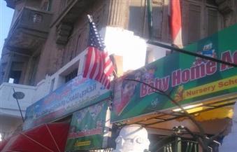 """بالصور.. رفع علم أمريكا علي """"حضانة"""" يثير غضب المحلاوية"""