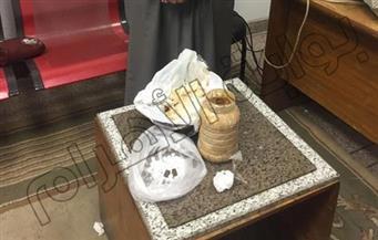 """ضبط حشيش وأقراص ترامادول في برطمان """"مش"""" مع راكب قبل السفر من مطار الأقصر"""