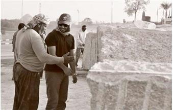 """بالصور.. المشاركون بـ""""سمبوزيوم"""" أسوان الدولى للنحت يبدأون العمل بالدورة الثانية والعشرين"""