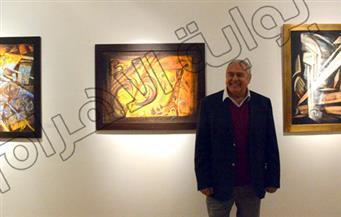 بالصور.. الفنان أيمن صلاح طاهر يعزف أنغامه بأربعين لوحة في قاعة الباب بدار الأوبرا