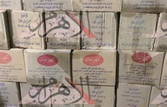 بالصور .. ضبط 4 أطنان سكر وزيت تمويني بحوزة مدير تسويق بقنا