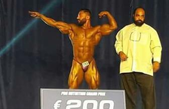 المصري رامي محمود يفوز بذهبية أفضل عرض برومانيا لكمال الأجسام   صور