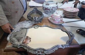 ضبط قطع أثرية من عصر الملك فاروق قبل سفرها إلي لبنان بالمطار|صور