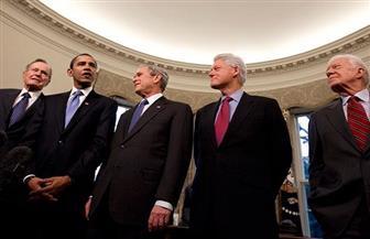 الرؤساء الأمريكيون السابقون يشاركون في حفل خيري دعما لضحايا الأعاصير