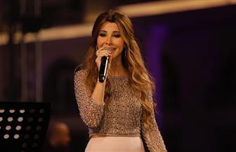 نانسي عجرم تحتفل بأحد السعف.. وابنتاها ترفعان الشموع | صور