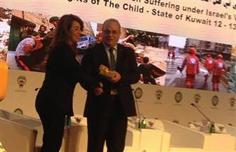 وزير التنمية الاجتماعية الفلسطيني يكرم غادة والي