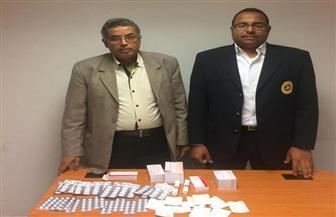 ضبط 400 قرص مخدر بحوزة راكب قادم من ألمانيا بمطار الغردقة| صور