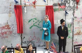 فنان بريطاني ينظم مراسم اعتذار صورية عن وعد بلفور في بيت لحم| صور