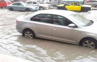 مياه الأمطار تغرق منطقة الكيلو 21 بالإسكندرية.. والصرف الصحي يدفع بسيارات لشفطها | صور