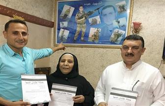 أسر شهداء الجيش والشرطة للرئيس: كمل علشان تبنيها | صور