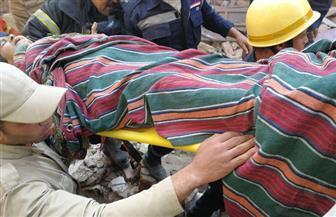انتشال مصابة أخرى من تحت أنقاض عقارات روض الفرج المنهارة | صور