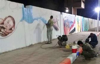الرسومات الفنية تزين شوارع سوهاج لاستقبال العام الجديد | صور