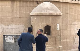 آثار الطلقات النارية بجدار كنيسة مارمينا بحلوان والارتكازات الأمنية المحيطة بها | صور