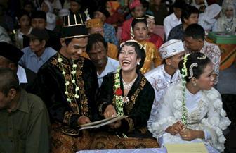 زواج جماعي لمئات الإندونيسيين في ليلة رأس السنة   صور
