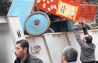 حملة موسعه بحي الدقي لرفع الإشغالات | صور