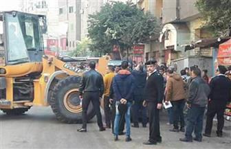 حملة أمنية لإزالة إشغالات بميدان الجيزة والشوارع المحيطة | صور