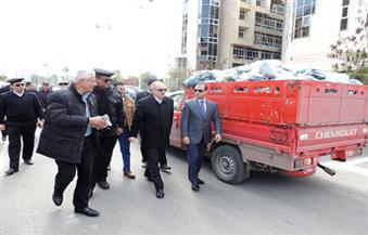 """بالصور.. أمن بورسعيد يضبط 5 أطنان ملابس مهربة  في """"الجرابعة"""""""