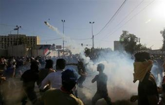 الأمن العراقي يستخدم الغاز المسيل للدموع لتفريق مظاهرة ضد العبادي في محافظة واسط