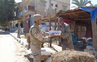 بالصور.. القوات المسلحة توزع آلاف الحصص الغذائية المجانية على أهالى العريش والشيخ زويد ورفح