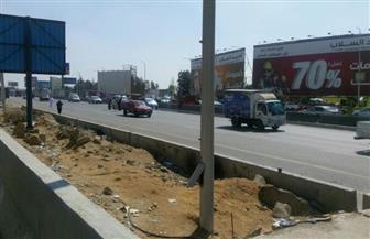 """بالصور.. إعادة فتح الطريق """"الدائري"""" بعد السيطرة على 80% من حريق خط الغاز بالتجمع"""