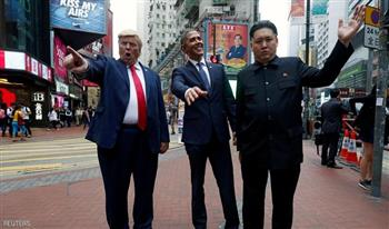 أشباه ترامب وأوباما وأون يتجولون في شوارع هونج كونج