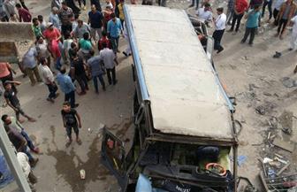 إصابة 6 أشخاص في حادث انقلاب أتوبيس من أعلى الدائري | صور