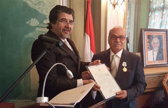 رئيس أفغانستان يمنح د. محمدعمارة وسامًا جمهوريًا تقديرا لكتاباته حول الأفغاني