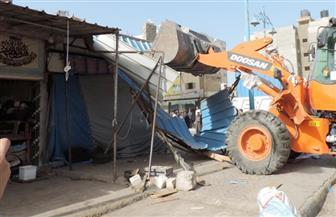 حملة لإزالة الإشغالات من شوارع حي حلوان