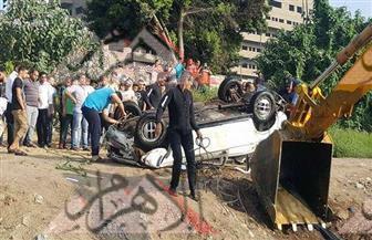 فرق الضفادع البشرية تنتشل جثث أسرة سقطت سيارتهم من أعلى كوبرى الساحل فى النيل | صور