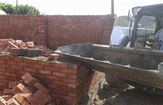 إزالة أعمال بناء لمقابر بدون ترخيص شرقي الإسكندرية