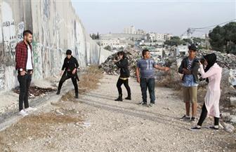 أقوى من الرصاص.. شباب فلسطيني بالضفة الغربية يلتقطون صورًا تعبيرًا عن المقاومة واستلهامًا للأمل | صور
