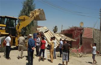 إزالة 5 حالات تعدٍ على طريق الفيوم - القاهرة الصحراوي | صور