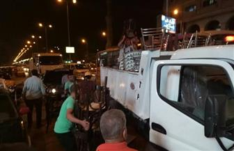 حي الدقي يشن حملة لإزالة الإشغالات بشارع التحرير والجمهورية | صور