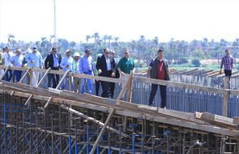 وزير النقل: انتهاء المرحلة الأولى من محور طما على النيل بداية مارس 2018| صور